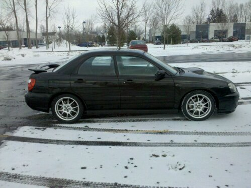 2004 Subaru Impreza WRX, in winter with 17x7 BBS RK wheels and General Altimax Arctic tires