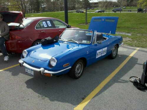bright blue 1972 Fiat 850 convertible at FLR SCCA autocross. Event at Rochester Institute of Technology, RIT, Rochester, NY