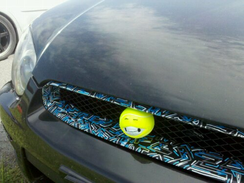 Subaru Get More G's yellow ball as a grill ornament, custom painted grill