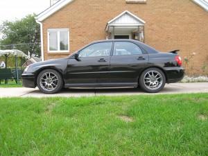 "RCE Yellow Springs and D-Spec Struts, cut bump stops, 2004 Subaru WRX Sedan, TIC Saggy Butt 1/4"" spacers in rear"