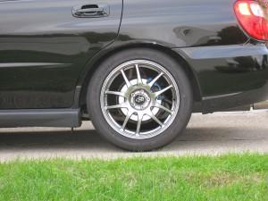 "RCE Yellow Springs and D-Spec Struts, cut bump stops, 2004 Subaru WRX Sedan, TIC Saggy Butt 1/4"" spacers in rear, side view rear wheel"
