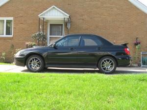 OEM Springs and Struts, side view, 2004 Subaru WRX Sedan, Java Black Pearl JBP