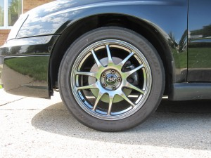 OEM Springs and Struts, side view front wheel, 2004 Subaru WRX Sedan, Java Black Pearl JBP
