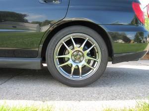 OEM Springs and Struts, side view rear wheel, 2004 Subaru WRX Sedan, Java Black Pearl JBP